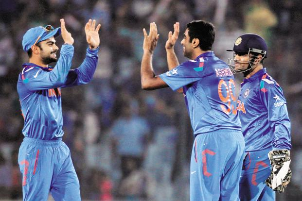 In the new BCCI central contracts, Virat Kohli (left) will make Rs7 crore while R. Ashwin (centre) and M.S. Dhoni will be paid Rs5 crore each. Photo: Reuters