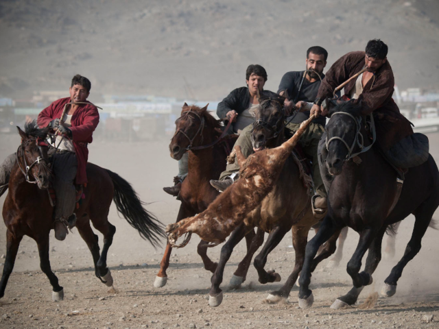In the Afghani sport buzkashi, players on horseback try to toss a decapitated goat carcass into the 'circle of justice.'