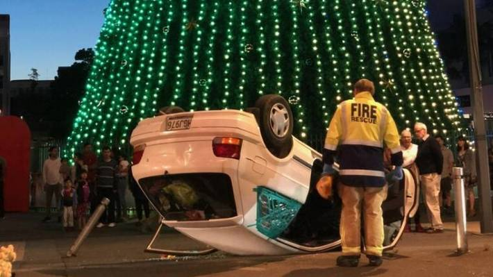 No-one was hurt when the car landed beside the Christmas tree in Garden Place.