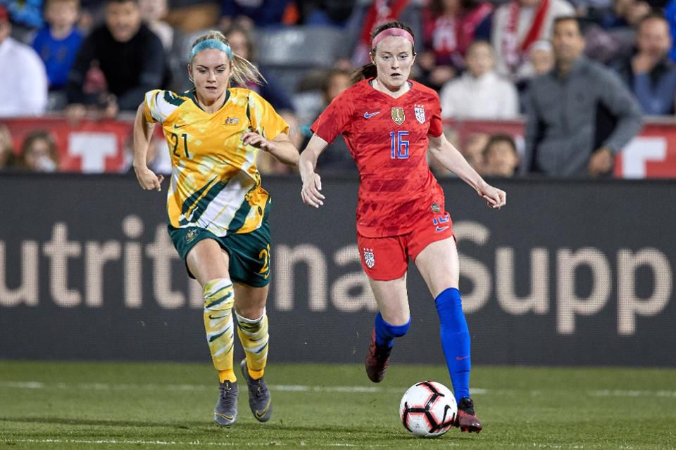 USWNT midfielder Rose Lavelle (16) battles with Australia defender Ellie Carpenter (21) during a friendly match on April 4, 2019, at Dick's Sporting Goods Park in Commerce City, CO. (Photo by Robin Alam/Icon Sportswire via Getty Images)